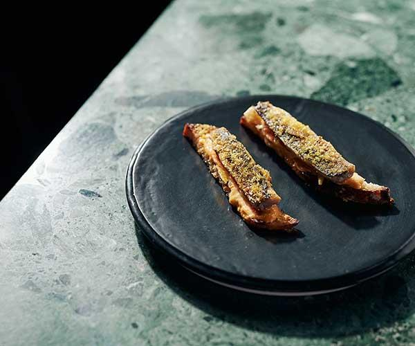"""**Sardines on toast, bottarga**  """"We grill fresh sardines then top them with microplaned bottarga and serve them with house-made escabeche-style pickles."""""""