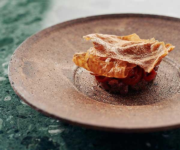 """**Raw lamb, red peppers, anchovy**  """"We serve this raw, after dry ageing the leg for about 10 or 12 days, before cubing it and serving it with a spicy red pepper puree, red pepper crackers and an anchovy cream.""""         *Estelle opens on Friday 8 February, 6pm-10pm, 243 High St, Northcote, Melbourne* [instagram.com/estellenorthcote](https://www.instagram.com/estellenorthcote/ target=""""_blank"""" rel=""""nofollow"""")"""