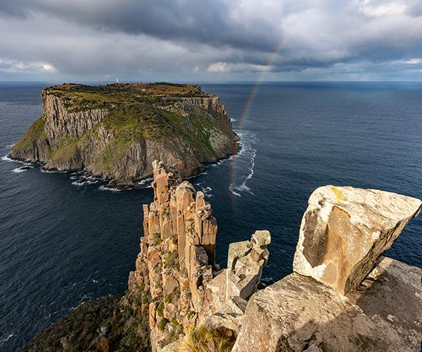 Despite its name, the walk spans only two capes (Cape Pillar and an optional side trip to Cape Hauy); the third landmark, Cape Raoul, is at the southern tip of the peninsula and can be seen from Crescent Lodge and the summit of Arthur's Peak, which we climb.   *(Photo: Luke Tscharke)*