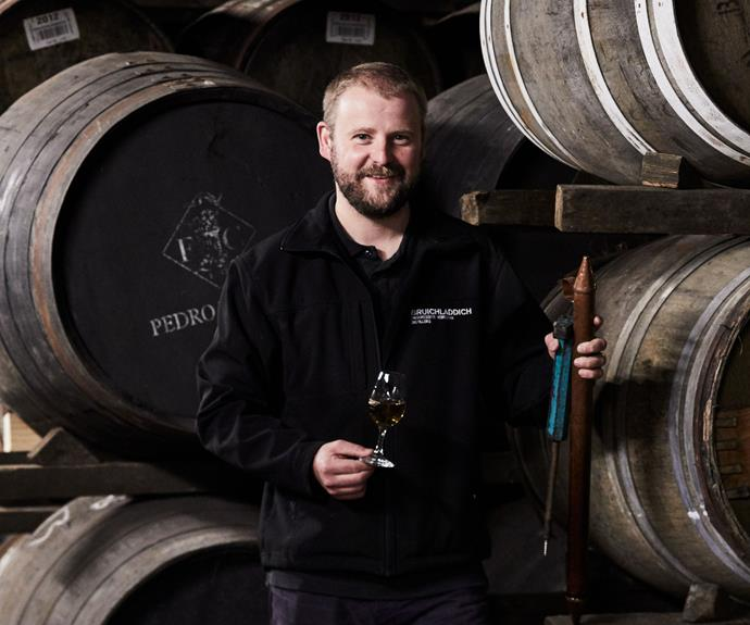 "***Bruichladdich head distiller Adam Hannett***   The island of Islay is famously damp, and all that shite weather, as well as generations of distilling skill and acres of peat create the alchemy that is Islay whisky. The defining characteristic of its prized single malts is peaty smoke – subtle when wrapped around dried fruit and leather flavours in a 15-year-old Bowmore; strident (or ""brutal"" was one barman's description to me) in a slug of Laphroaig 10. Peat banks are everywhere – 12,000 years in the making, cut neatly across sodden fields. With no coal and few trees, peat is the island's traditional fuel. It burns smokily – the tarry smell is on the wind as we approach the malting silos at Port Ellen – and for centuries it's been used to dry the barley that makes whisky, imparting the unmistakable nose and flavour of Islay. Peter the barman surveys 600 whiskies behind the bar at the Bowmore Hotel. His collection runs to 1,500 bottles, ""and I'm always picking up more"", he says. With AC/DC on the jukebox and a bristling dartboard in the corner, it's a no-nonsense introduction to Islay's finest. He pours me an unpeated 12-year-old from Bunnahabhain, to prove the point that Islay is more than smoke and mirrors. And then a Lagavulin 16: robust, complex – and very peaty."