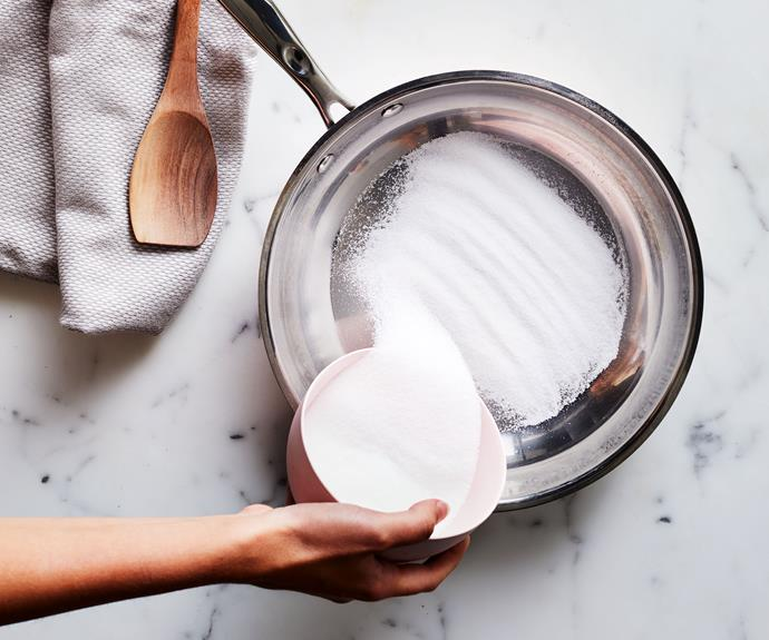 **Step 1**   Scatter 100gm sugar evenly across the base of a large, deep frying pan. Place over medium-high heat and watch the sugar carefully. Stir it a little to make sure the bottom doesn't burn before the top has melted and wait until it starts to turn golden (2-3 minutes).