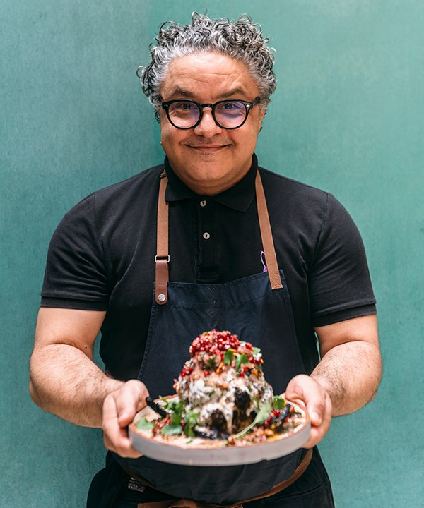 Chef Athanasios Kargatzidis holds Baron's dish of roasted cauliflower with tahini yoghurt and pomegranate