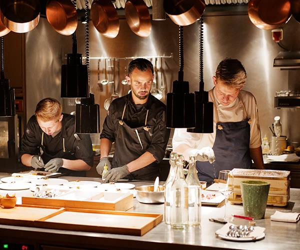 Chef Max Natmessnig (right) and his team at the Schualhus's chef's table.