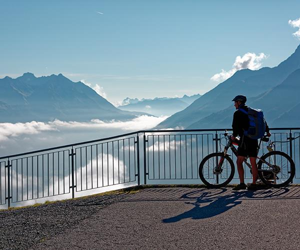 A mountain biker takes in the view at St Anton am Arlberg.