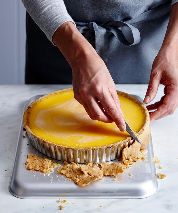 Trim the tart while it's still warm