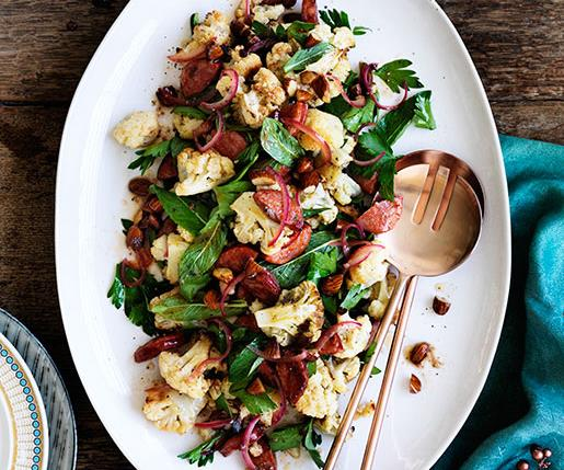 "**[Chorizo, roasted cauliflower and almond salad](http://www.gourmettraveller.com.au/recipes/fast-recipes/chorizo-roasted-cauliflower-and-almond-salad-13662|target=""_blank"")**"