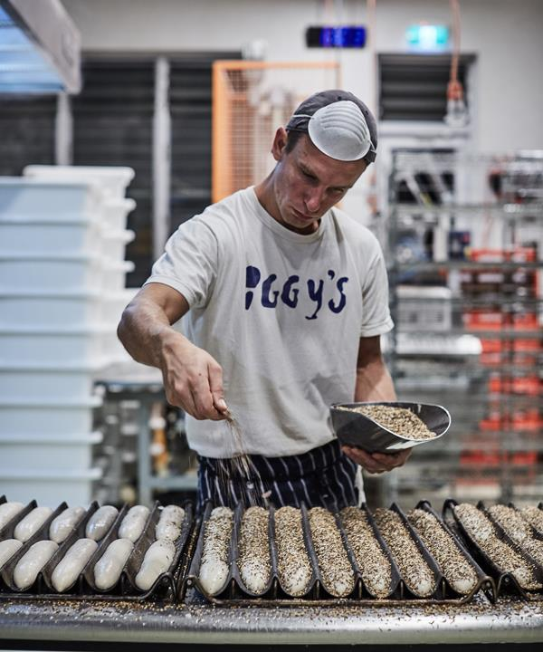 Iggy's makes bread, but really it starts with people. Milos, a former electrician from Belgrade, for example, has worked here for five years; Linda, a trained pastry chef from Indonesia, has been here seven.  *Baker Milos Misic.*