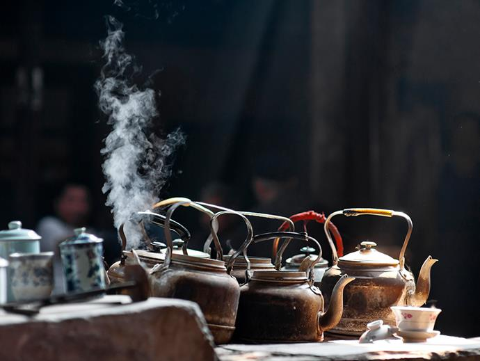 Kettles on stove in old tea house, Chengdu. Photo: Getty Images