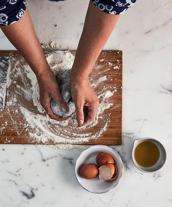 Knead dough until smooth and elastic (15-20 minutes). Kneading develops the gluten – the dough should bounce back slowly if you press on  it. Wrap it in plastic wrap and rest at room temperature for 15-30 minutes, or refrigerate for up to 5 days.