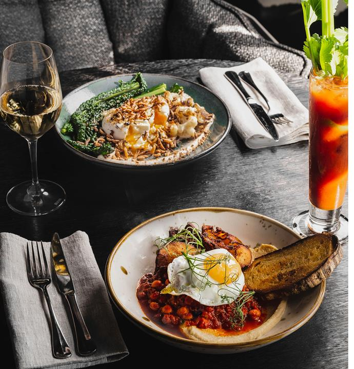 Stillwater's breakfast Bloody Mary made with Hartshorn Sheep Whey Vodka, and a green bowl of roasted cauliflower, almond cream, quinoa, kale and poached eggs.