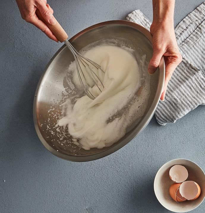 In a clean, dry bowl, whisk eggwhites until about medium-stiff peaks, being careful not to over-whip