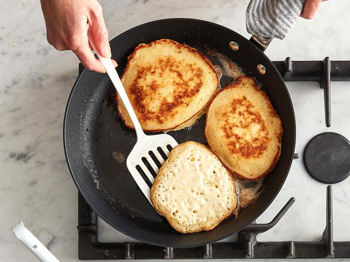 Heat a cast-iron skillet or a non-stick frying pan over medium-low heat and add as much butter as you like to the pan, the more the better; they're pancakes, not muesli – treat yourself.  <br> Add a few ladles of batter to create rounds and let the batter fry in the pan until a lot of bubbles come to the surface (2-3 minutes). Flip, and cook until set on the bottom (2-3 minutes). The more butter you use (well, to a point), the crisper your pancakes will be.  <br> Serve warm with whatever toppings take your fancy.