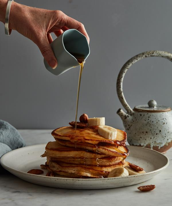 My favourite toppings are fresh sliced banana, roasted pecans, and maple syrup. In Australia, malt syrup is an awesome alternative. Stay away from the fake maple stuff. I am also a sucker for pancakes with canned peaches and crème fraîche – it sounds naff, but it's super tasty.