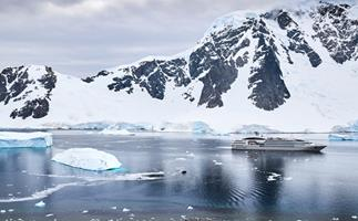 Hikers' view of Ponant's *Le Soléal* anchored off Danco Island.
