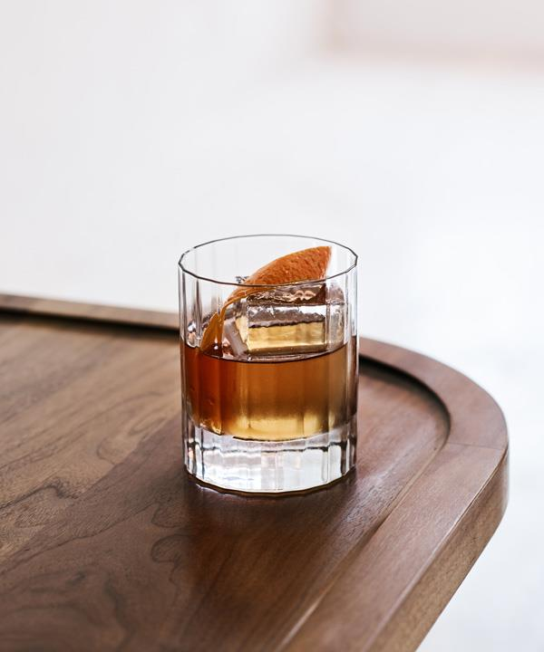 The Wall Street cocktail, with dry orange and cherry-cooked bourbon, spiced burnt honey, and sandalwood.