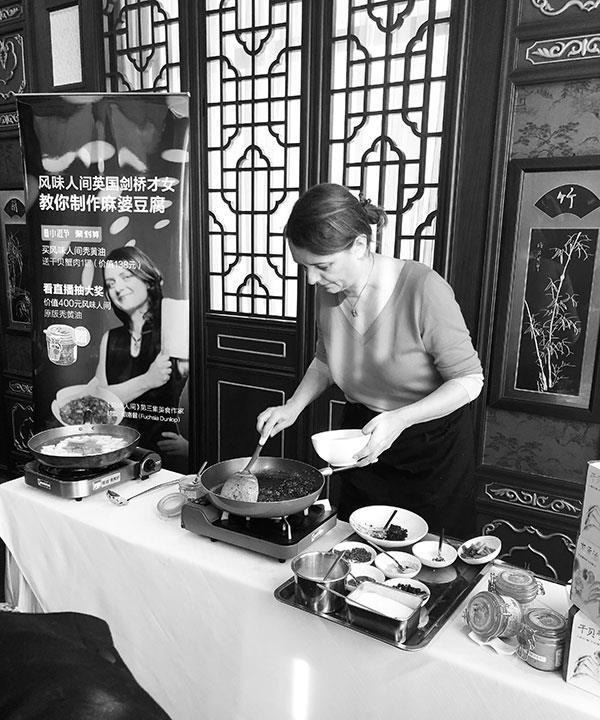 Fuchsia Dunlop cooking ma po tofu with hairy crabmeat relish for a live webcast in Shanghai, 2018.