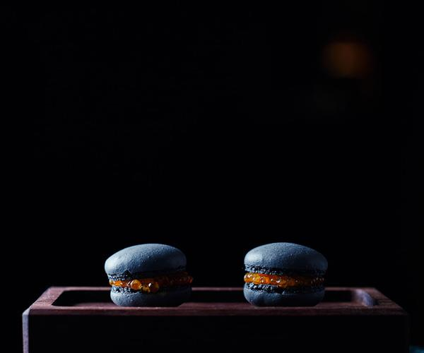 Squid-ink macaron, trout roe.