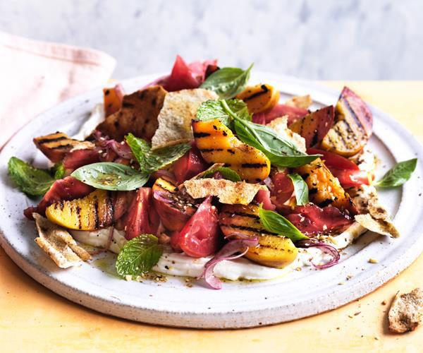 "**[Grilled peach, tomato and labne with crisp flatbread](https://www.gourmettraveller.com.au/recipes/fast-recipes/grilled-peach-tomato-and-labne-with-crisp-flatbread-15540|target=""_blank"")**"