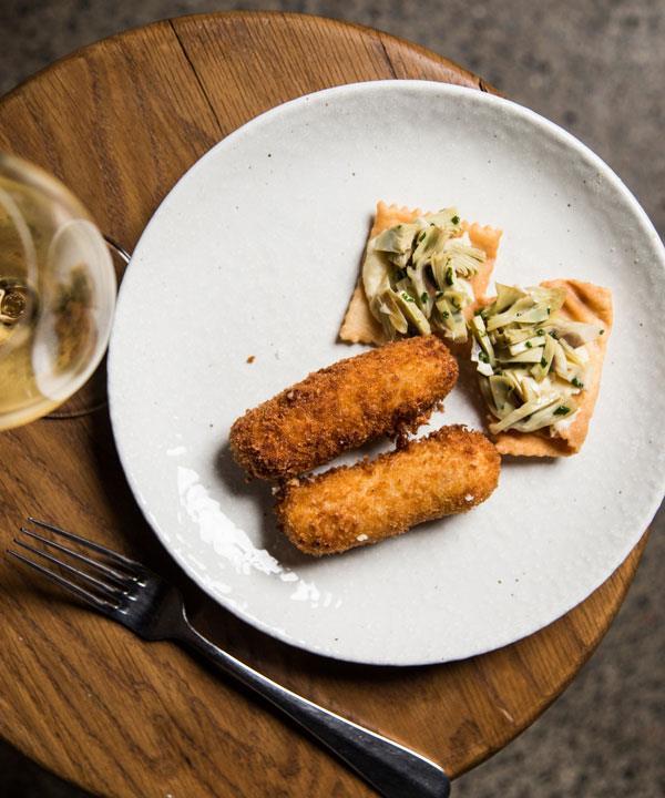 Croquettes of pork belly, Taleggio and kimchi; globe artichoke tartare, pecorino, pasta fritta.