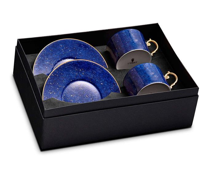 "With its midnight blue colours and 24-carat gold detailing, this porcelain cup-and-saucer set is inspired by the star-studded skies of the Mediterranean. It makes for an elegant addition to any fine china selection, and for morning tea times to come. <br><br> L'Objet Lapis Tea Cup & Saucer Gift Set, approx. $479 AU, [LuxDeco.com](https://www.luxdeco.com/collections/luxury-tea-coffee-sets/products/lapis-tea-cup-saucer-gift-set|target=""_blank""