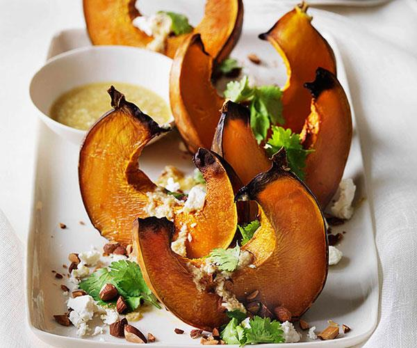 "**[Roast pumpkin wedges with almonds, goat's cheese and tahini dressing](https://www.gourmettraveller.com.au/recipes/browse-all/roast-pumpkin-wedges-with-almonds-goats-cheese-and-tahini-dressing-10461|target=""_blank"")**"
