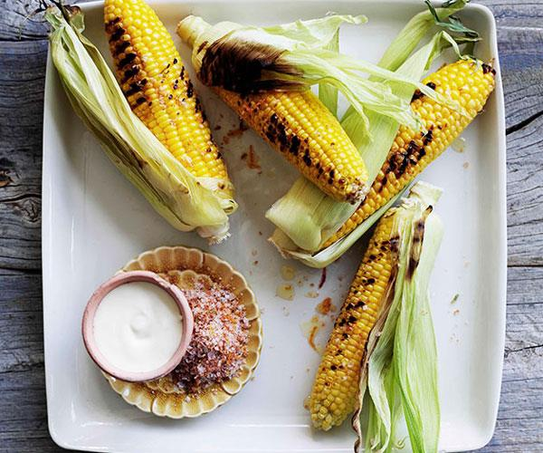 """**[Barbecued corn with chipotle salt and sour cream](https://www.gourmettraveller.com.au/recipes/browse-all/barbecued-corn-with-chipotle-salt-and-sour-cream-10874