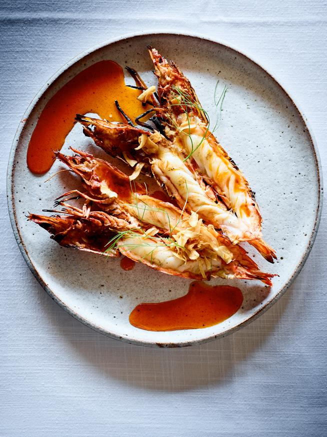 "**[Wood-grilled prawns with fried garlic and chilli oil](https://www.gourmettraveller.com.au/recipes/chefs-recipes/garlic-prawns-chilli-17764|target=""_blank"")**  **Recipe:** Andrew McConnell  **Styling:** Lisa Featherby **Photography:** Mark Roper **Magazine issue:** July 2019"