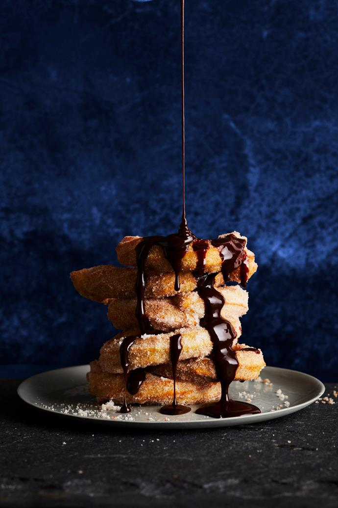 "**[Churros with chocolate sauce](https://www.gourmettraveller.com.au/recipes/browse-all/churros-chocolate-sauce-17154|target=""_blank"")**  **Recipe & styling:** Lisa Featherby **Photography:** Alicia Taylor **Magazine issue:** April 2019"