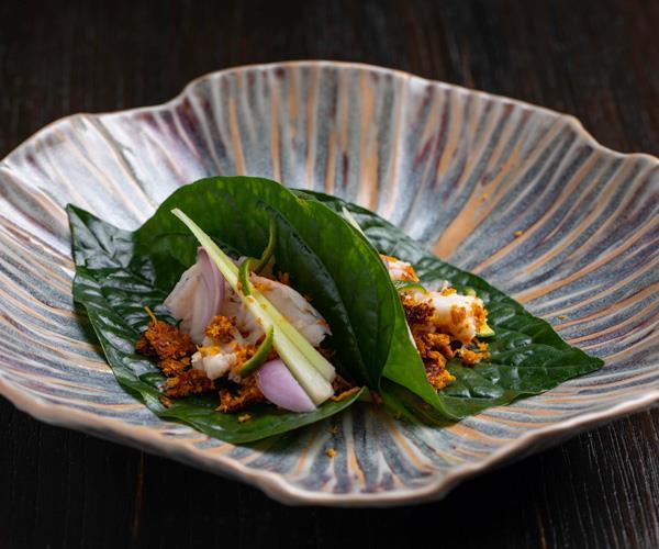 Shrimp paste and prawns in betel leaves.