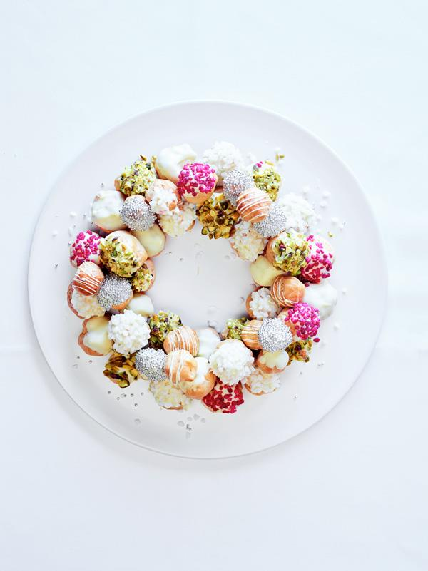 "**[White chocolate and pistachio profiterole wreath](https://www.gourmettraveller.com.au/recipes/chefs-recipes/profiterole-wreath-18040|target=""_blank"")**  **Recipe:** Lauren Eldridge **Styling:** Lisa Featherby **Photography:** Mark Roper **Magazine issue:** December 2019"