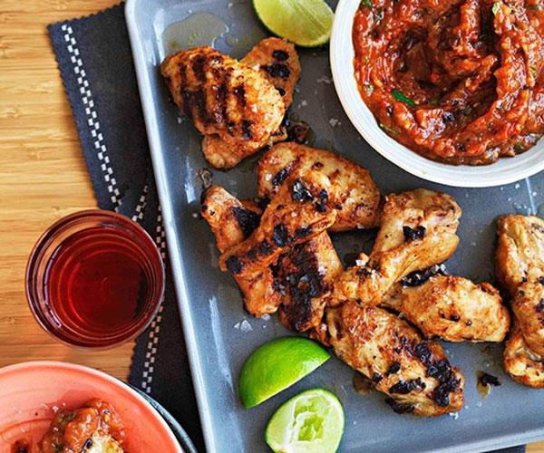"**[Spiced chicken wings with roast garlic and chipotle salsa](https://www.gourmettraveller.com.au/recipes/browse-all/spiced-chicken-wings-with-roast-garlic-and-chipotle-salsa-14311|target=""_blank"")**"