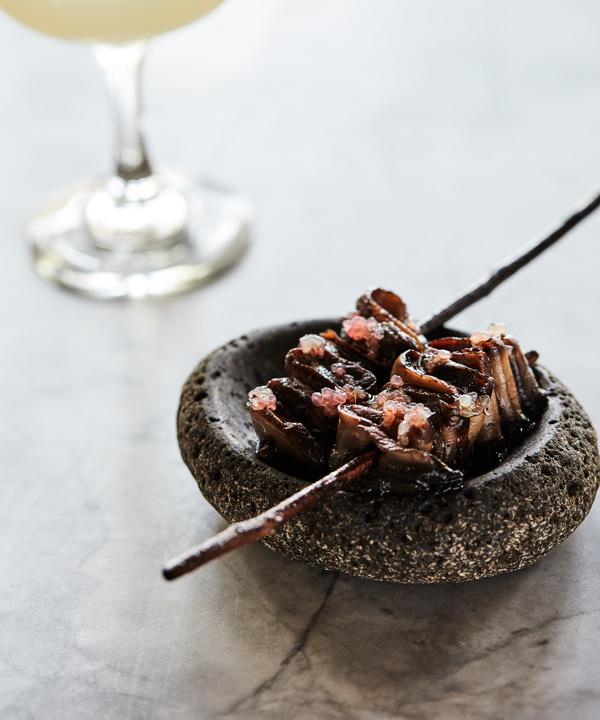 Grilled mushrooms with finger lime.