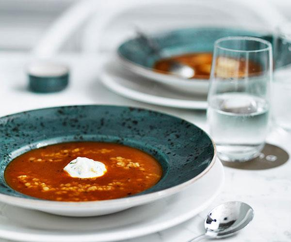 """**[Roast tomato soup with trahanas, Greek-style yoghurt and basil](https://www.gourmettraveller.com.au/recipes/chefs-recipes/roast-tomato-soup-with-trahanas-greek-style-yoghurt-and-basil-7913