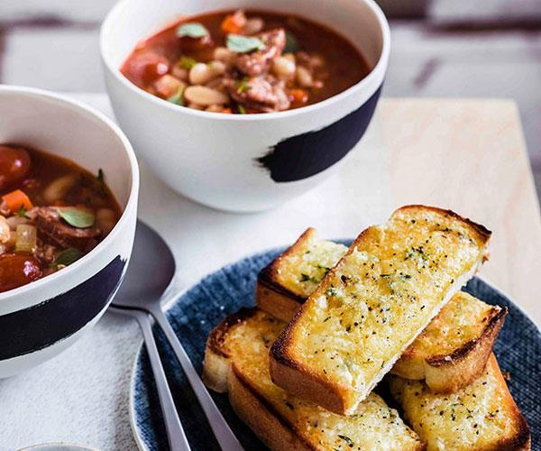 """**[Bean, chorizo and tomato soup with manchego soldiers](https://www.gourmettraveller.com.au/recipes/browse-all/bean-chorizo-and-tomato-soup-with-manchego-soldiers-11298