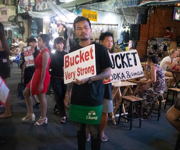 Bar hawkers advertising buckets of alcohol on Khao San Road.
