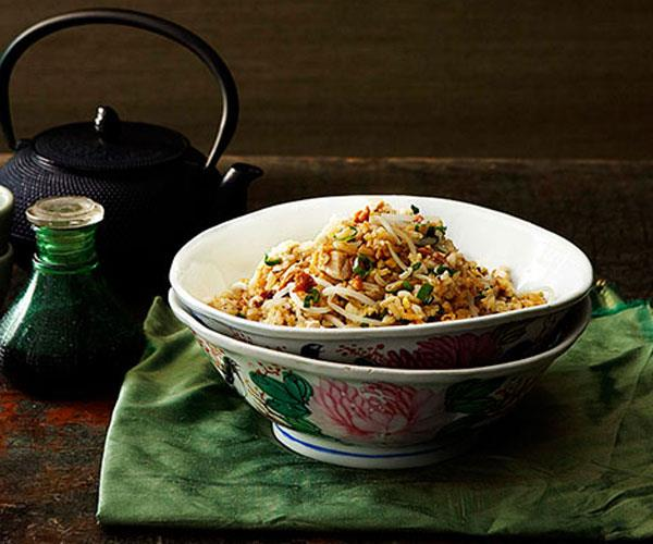 """**[Tony Tan's Cantonese fried rice with chicken, salted fish and bean sprouts](https://www.gourmettraveller.com.au/recipes/chefs-recipes/cantonese-fried-rice-with-chicken-salted-fish-and-bean-sprouts-7304