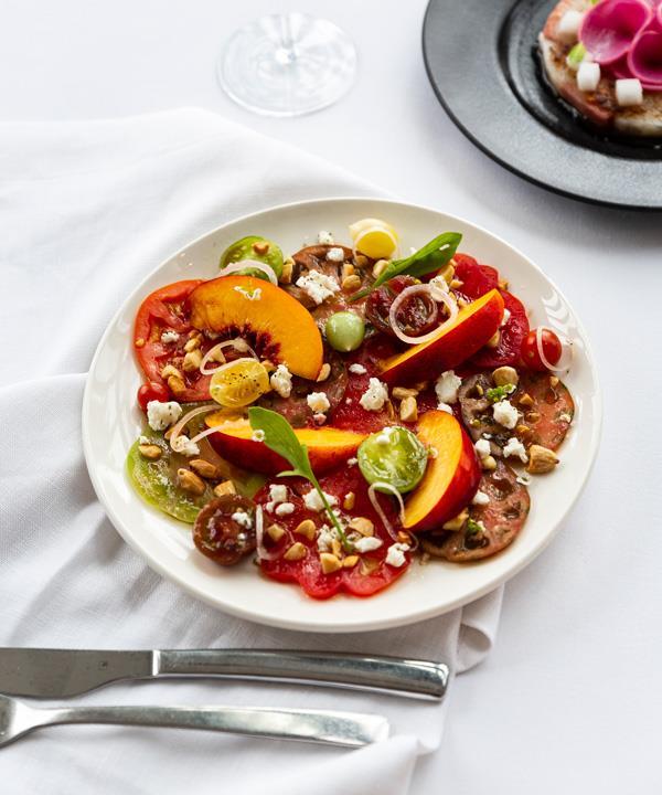 Heirloom tomato crudo, Meredith feta, stone fruit, almonds and their oil.