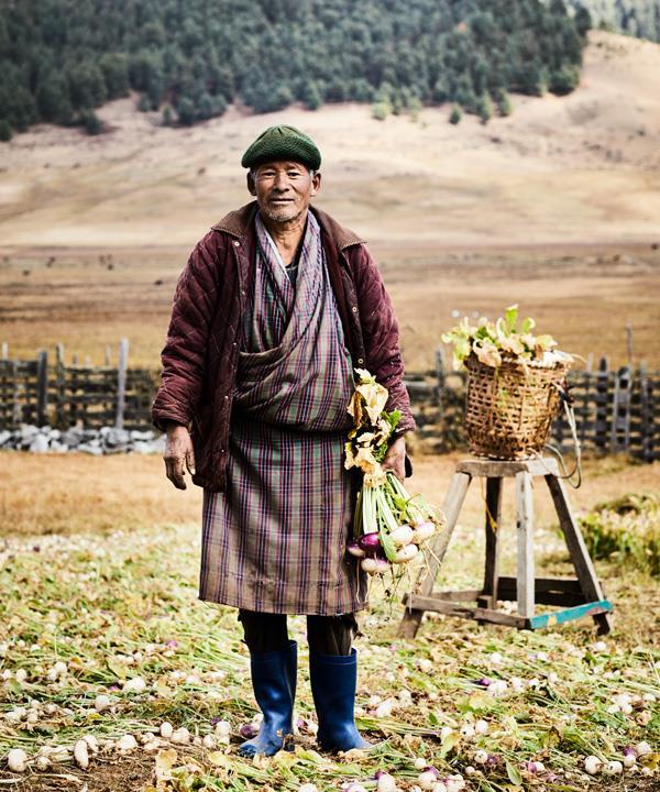 A turnip farmer wearing a traditional gho (draped tunic).