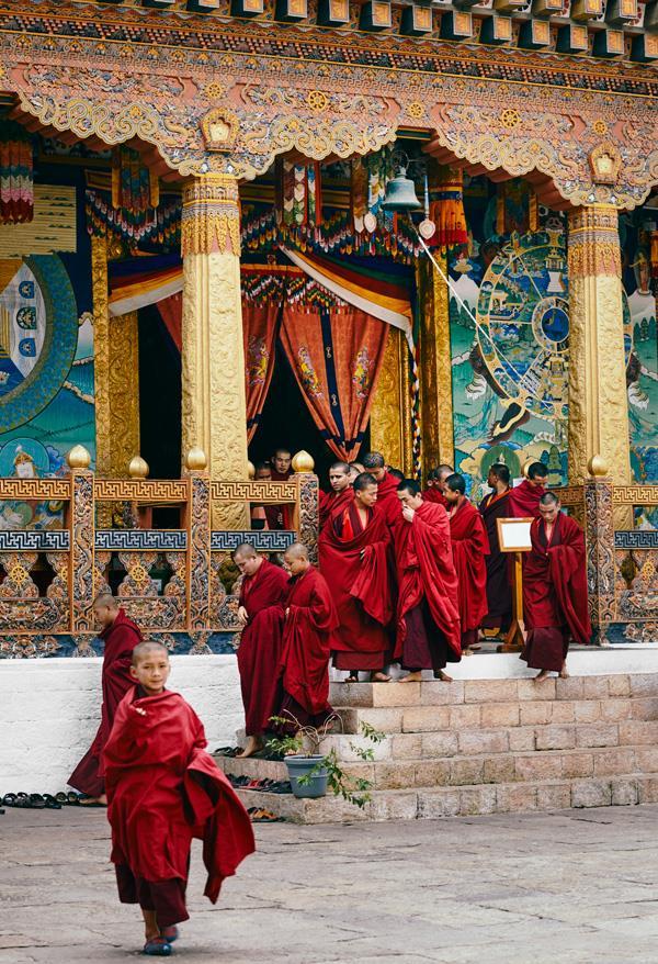 Young Buddhist monks leave the Punakha Dzong.