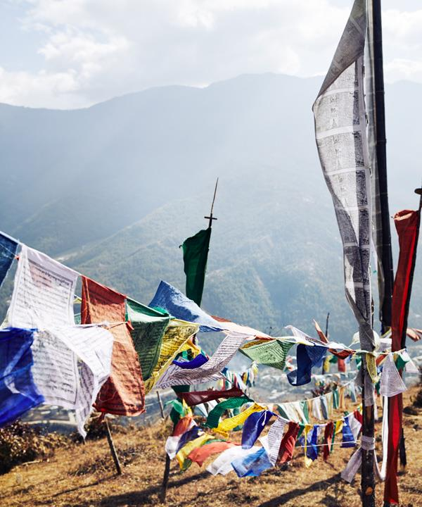 Prayer flags strung high in the mountains above Thimpu.