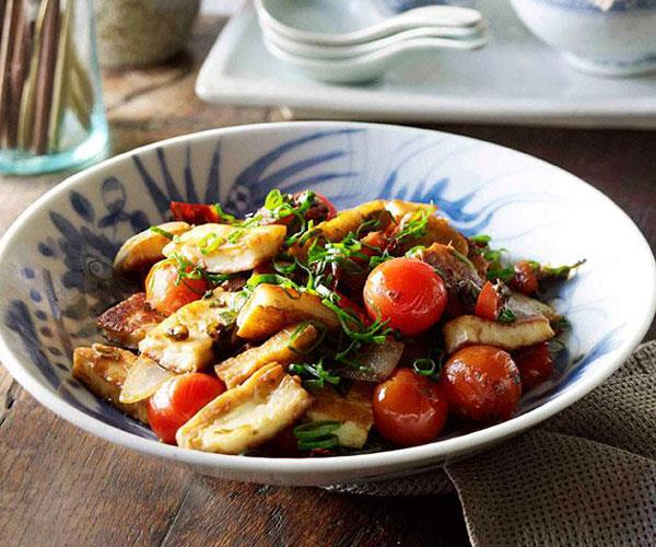 """**[Naxi-style fried goat's cheese, spring onions and tomatoes (Chao rubing)](https://www.gourmettraveller.com.au/recipes/browse-all/naxi-style-fried-goats-cheese-spring-onions-and-tomatoes-chao-rubing-11249