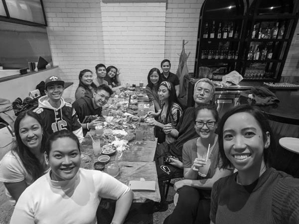 Janine Barican and staff at Chibog on its last day of trading before the March lockdown. Head chef Alex Lin (with glasses) is seated mid-right, and Thuan Le is seated back-right.