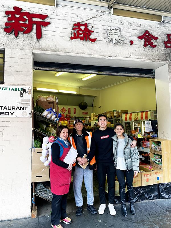 Irene and Chi Ching Fu, son Danny Fu and Danny's partner Jen Ng at the front of Season's Fruit Market.