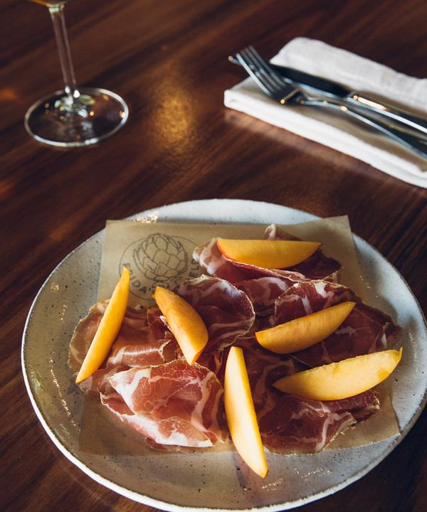 Homemade bresaola and capicola with pickled peaches.
