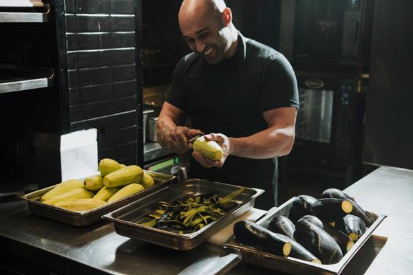 Shane Delia preparing food at his restaurant Maha in Melbourne.