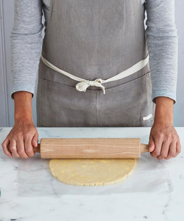 Step 6: Roll the pastry between two sheets of Go-Between to stop it sticking to the bench.