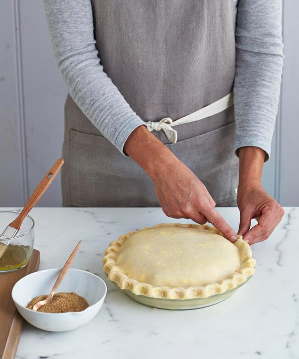 Step 8: Trim the pastry lid, then press and crimp the edges together.