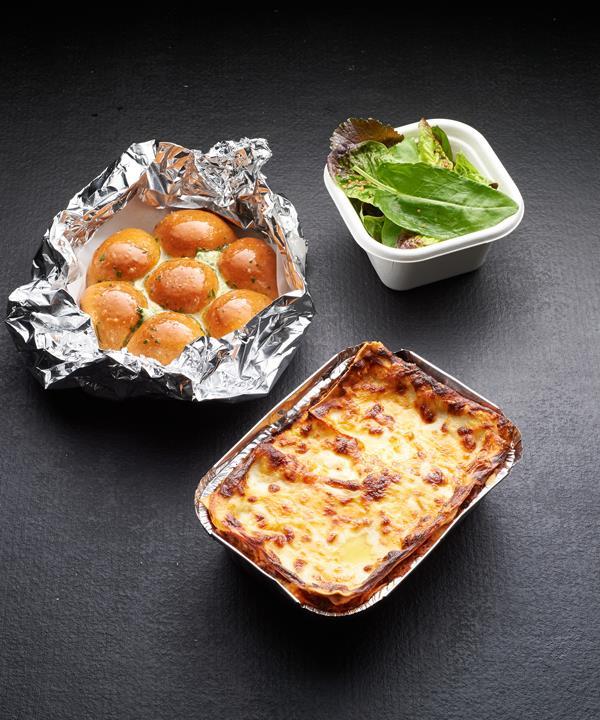 Attica at Home's beef lasagne, garden salad and pull-apart garlic bread.