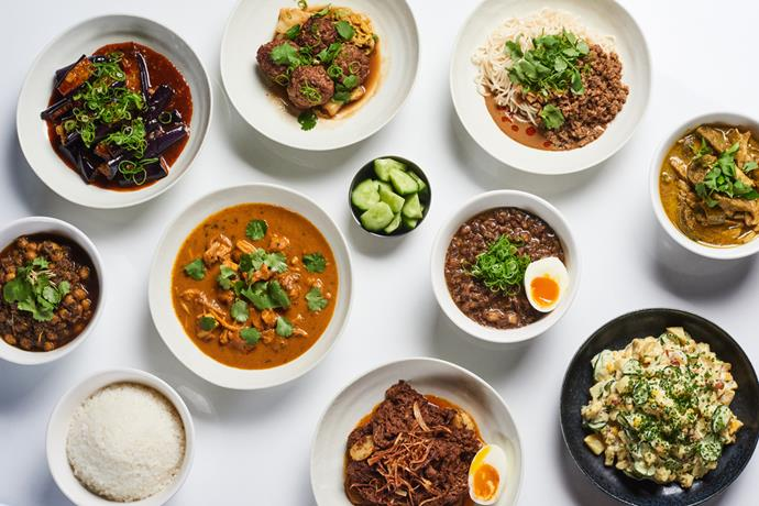 Lagoon Dining's range of ready-to-heart meals, including (clockwise from far left) chana masala spiced chickpea curry, vegan fish-fragrant eggplant, lion's head meatballs, dan dan noodles, green chicken curry, Japanese potato salad, beef rendang, butter chicken and lu rou fan.
