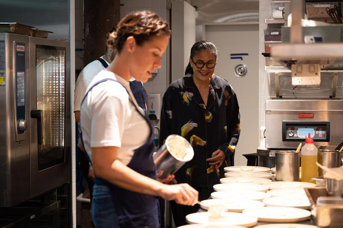 Jacqueline Challinor prepares the next course while Kylie Kwong watches on.